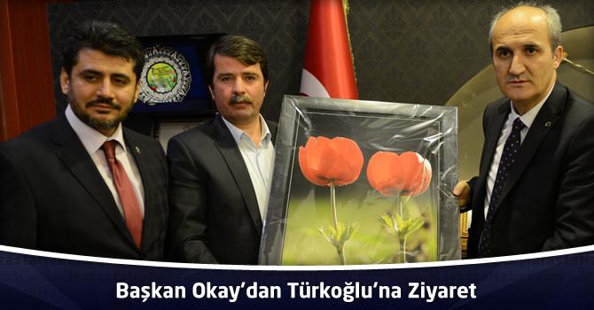 Başkan Okay'dan Türkoğlu'na Ziyaret