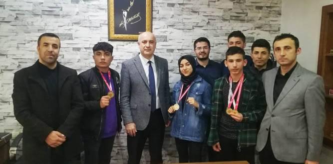 Şampiyon,Türkoğlu İlçe Millî Eğitim Müdürünü Ziyaret Etti